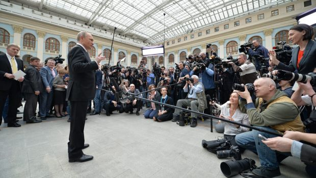 Mr Putin speaks to the media after his call-in TV show in Moscow.
