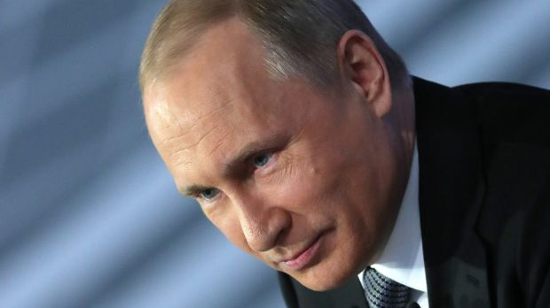Mr Putin listens for a question during his annual call-in show in Moscow.
