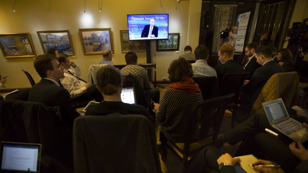 Journalists watch as Mr Putin speaks during his highly choreographed annual call-in show.