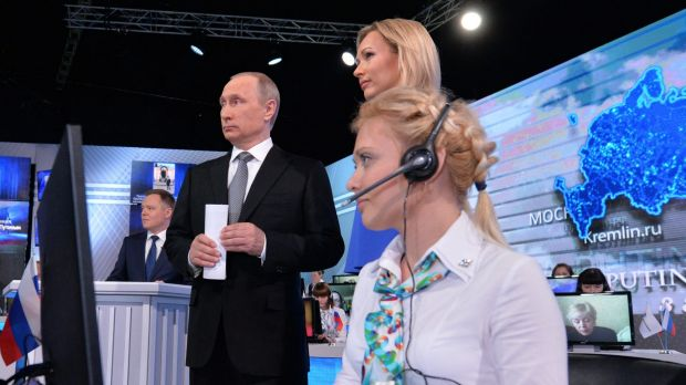 Russian President Vladimir Putin stands next to TV presenter Valeria Korablyova, during his marathon call-in TV show in ...