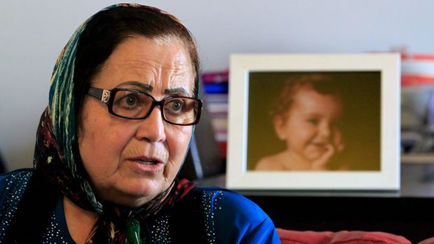 Ibtisam Berri with a picture of her granddaughter Lahala Elamine, at her home in the southern suburbs of Beirut.