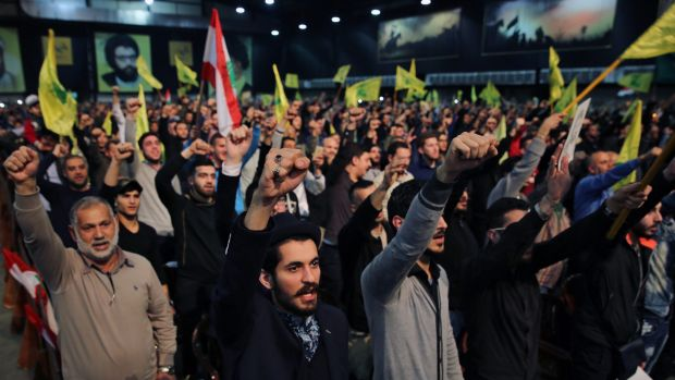Supporters of the Lebanese Shiite party Hezbollah cheer as they listen to a speech by their leader Hassan Nasrallah in ...