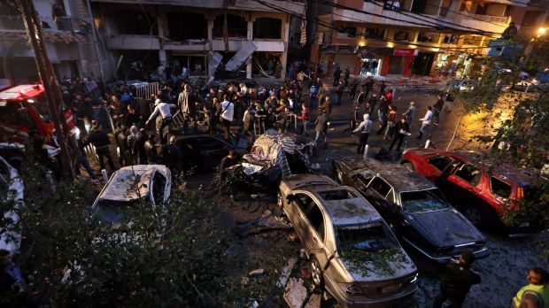 Lebanese gather at the site of an explosion during rush hour in southern Beirut, the stronghold of Hezbollah, in January ...