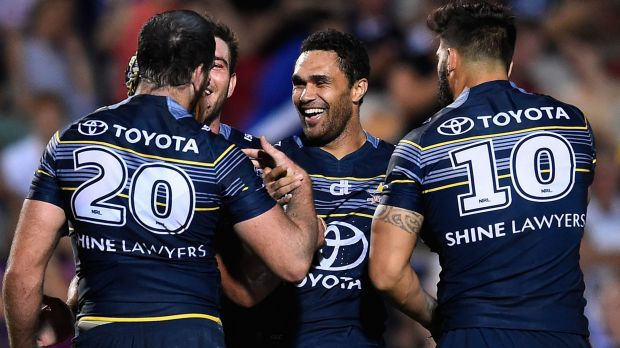Playing like premiers: The Cowboys celebrate one of many tries against Souths.