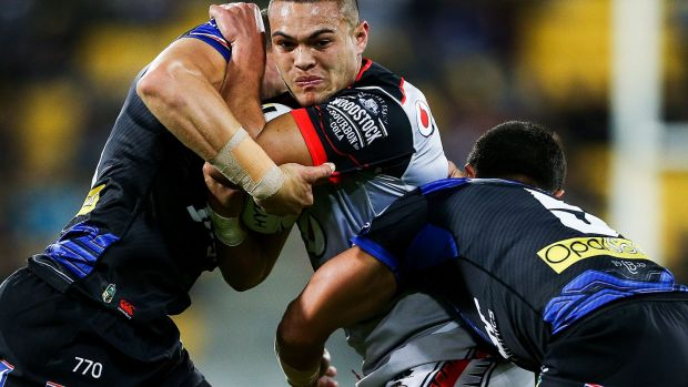 In a dogfight: Warrior Tuimoala Lolohea meets some opposition.