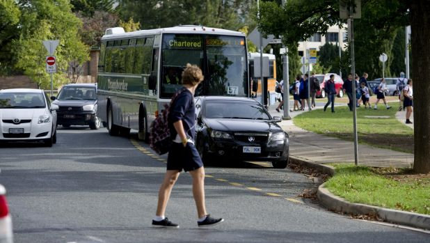A student walks towards Telopea Park School.
