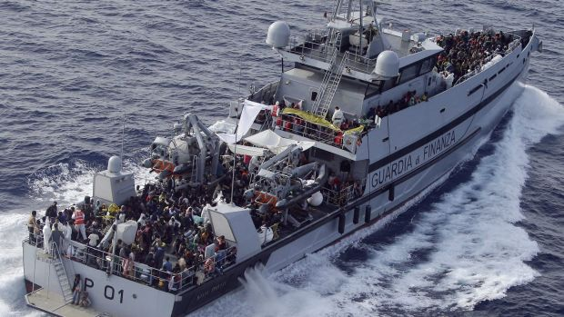 Ongoing crisis: Italian border police in the Mediterranean Sea, heading to the Island of Lampedusa, southern Italy in ...