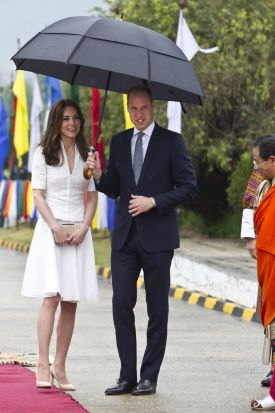 Prince William, Duke of Cambridge and Catherine, Duchess of Cambridge bid farewell at Paro Airport before boarding their ...