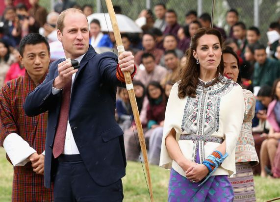 Catherine, Duchess of Cambridge judges Prince William's arrow firing ability during an Bhutanese archery demonstration ...