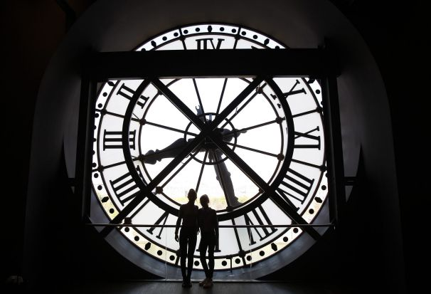 A picture shows a clock taken from inside of the Orsay museum in Paris, France.