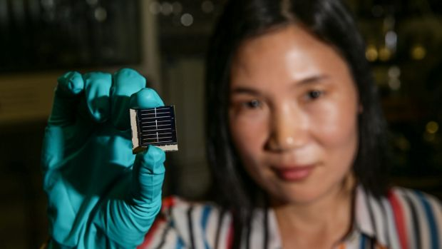 Hao Xiaojing, a lead researcher at UNSW, holds one of the new solar cells her team has developed.