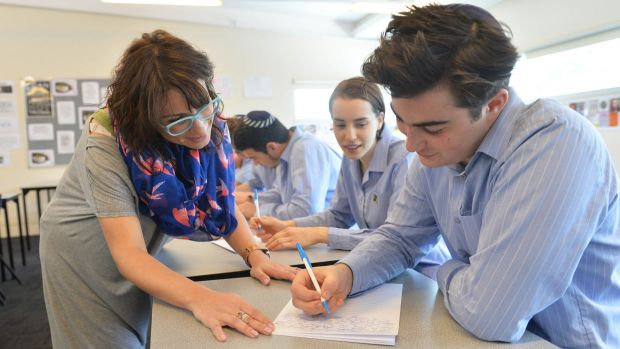 Leibler Yavnel college head of senior school English Rachel Kafka with year 12 students using pens and paper.