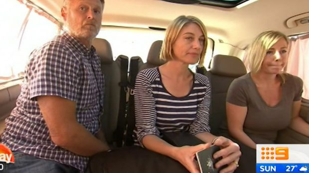 Reporter Tara Brown, centre, sound recordist David Ballment, left, and Sally Faulkner, right, after being released from ...