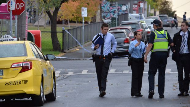 Police at the scene of the fatal stabbing in Fitzroy.