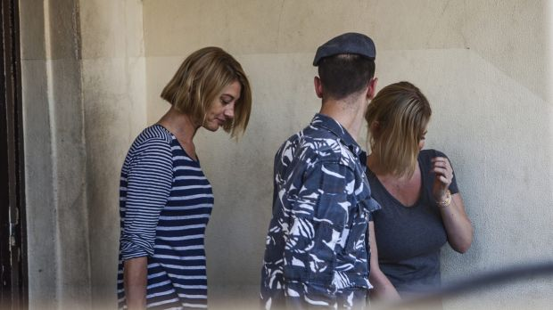 Tara Brown, left, and Australian mother Sally Faulkner, right, leave a women's prison in the Beirut southeastern suburb ...