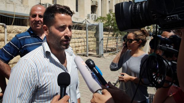 Lebanese father Ali Elamine speaks to journalists after dropping charges against his estranged wife and the <i>60 ...