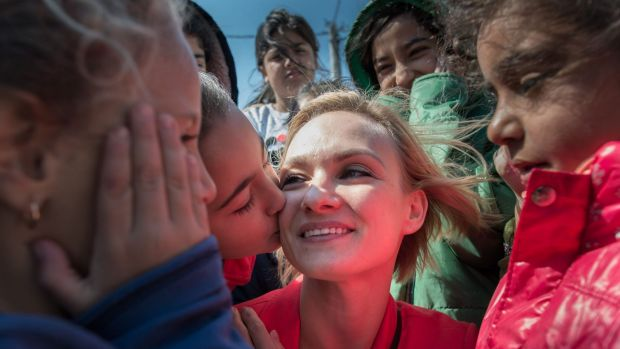 Personal touch: Irina Kolesnikova meets refugees at the Tabanovce refugee camp in Macedonia.