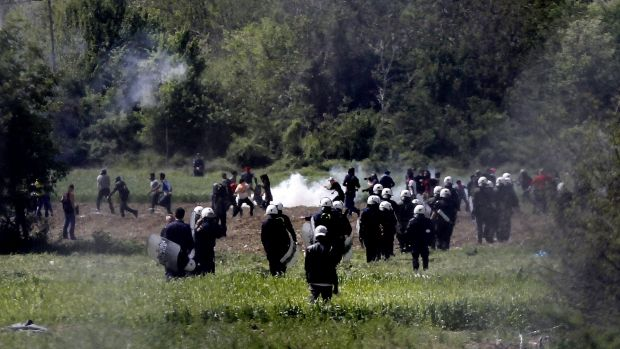 Riot: Greek police deploy along the border with Macedonia.