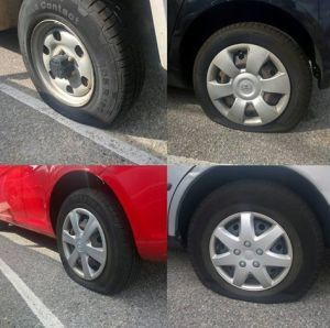 A montage of slashed tyres.