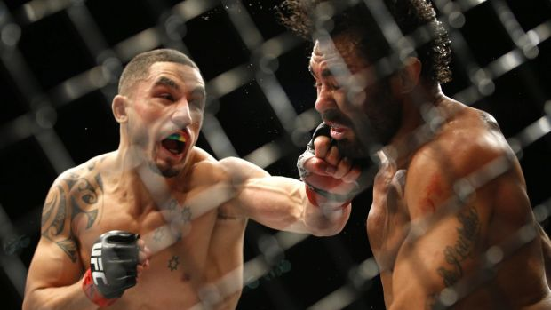 Winning streak: Robert Whittaker hits Rafael Natal during what became his fifth straight win in the UFC.