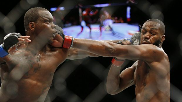 Slug fest: Ovince Saint Preux, left, and Jon Jones trade blows.