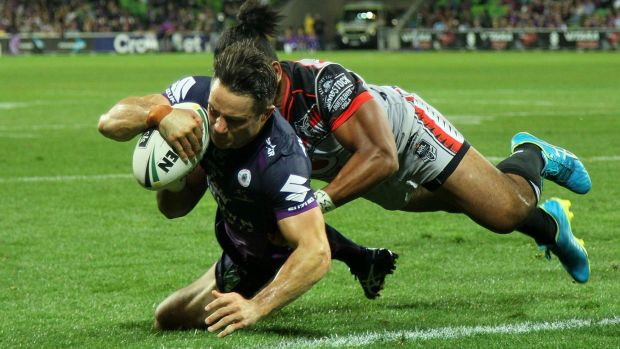 Cooper Cronk of the Storm about to touch down.