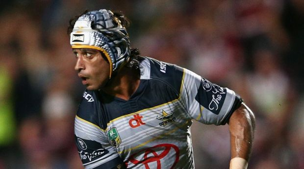 Johnathan Thurston of the Cowboys passes during their match against the Cowboys.