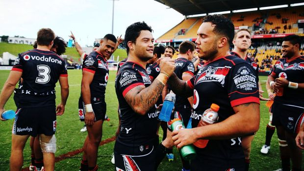 At last: Issac Luke and Jazz Tevaga celebrate their win over the Dragons.