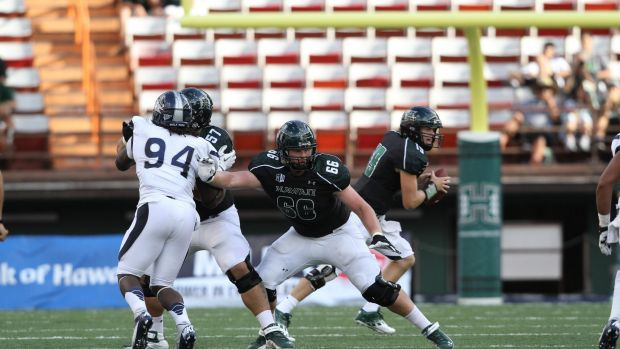 Blake Muir, wearing No.66, playing for the University of Hawaii college football team.