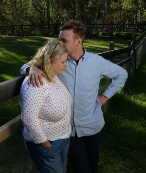 Jane Robinson, left, being comforted by her son Anthony.