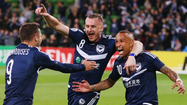 Veteran Archie Thompson (right) celebrates with Besart Berisha and Kosta Barbarouses (left) after scoring against Gamba ...