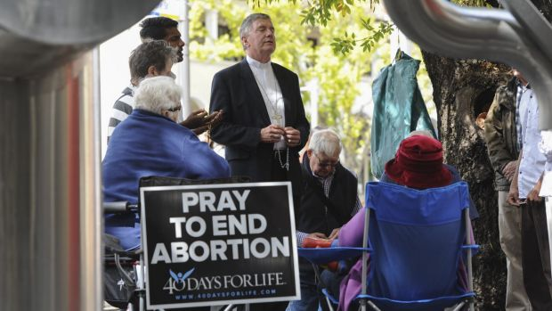 The Catholic Archbishop of Canberra and Goulburn, Christopher Prowse, joined a prayer vigil outside the Moore Street ...