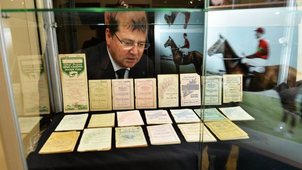 Max Williamson with orginal race books listing Phar Lap's races, all to be auctioned.
