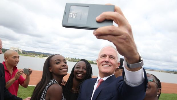 Malcolm Turnbull takes a selfie with new Australian citizens Lydia Banda-Mukuka and Chilandu Kalobi Chilaika on ...