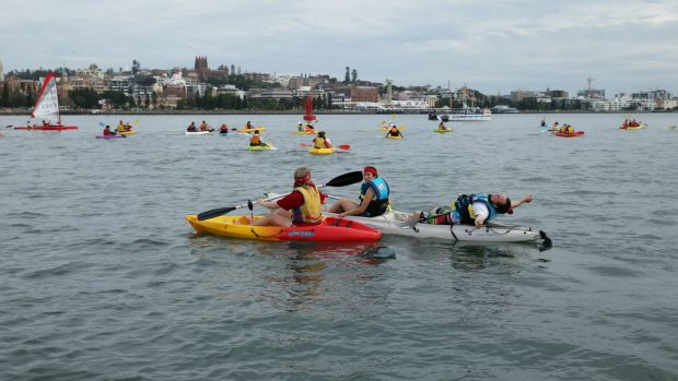 Protesters in kayaks in Newcastle harbour.