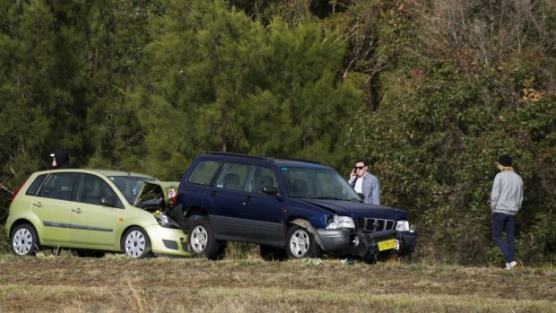 A crash on the Monaro Highway. The ACT government's first citizen jury will look at proposed changes to compulsory ...