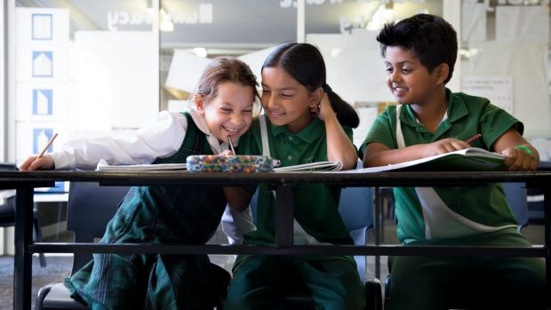 Year 3 students from St. Anthony's in Girraween (from left) Zoe Atkinson, 8, Mokshada Rane, 8, and Aryan Sawant, 8 sit ...