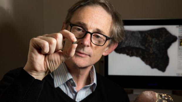 Peter Hiscock with the axe fragment, the oldest in the world.
