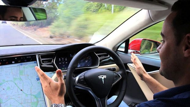 Self-driving cars like the Tesla could send the economy on a wild ride.