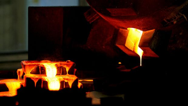 Mixed gold and silver are poured into ingot moulds at the furnace facility of Akara Mining's Chatree gold mine near ...