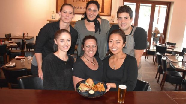 Tall Timbers Manjimup staff with one of chef Michael Hill's award-winning steak sandwiches.