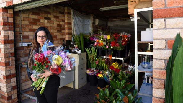 Florist Rita Sakr at work in her garage after she had to close her shop when she wasn't paid by Ready Flowers.