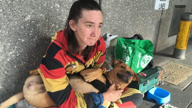 Homeless woman Jodi Cooper with her dog, Brownie.