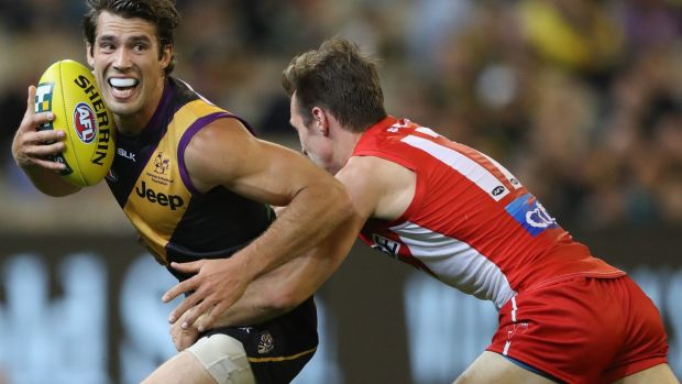 Alex Rance of the Tigers is challenged by Jack Hiscox of the Swans.