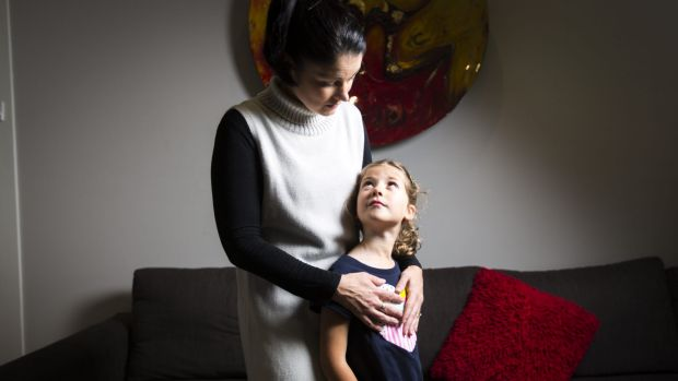 Simone Cariss with her six-year-old daughter Asha. Simone is petitioning for Asha to be able to wear pants as part of ...