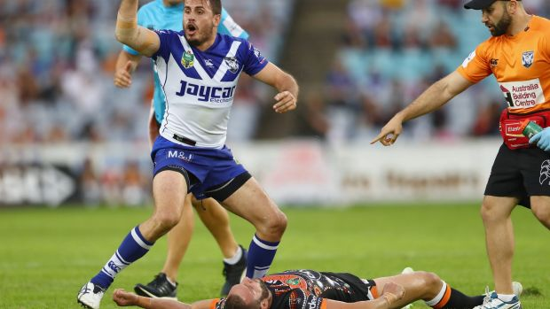 Josh Reynolds calls for medical assistance after the collision with Robbie Farah.