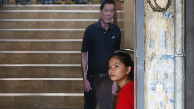 A life-size cutout of Rodrigo Duterte by the stairs for customers to take a selfie at a restaurant in his hometown in Davao.