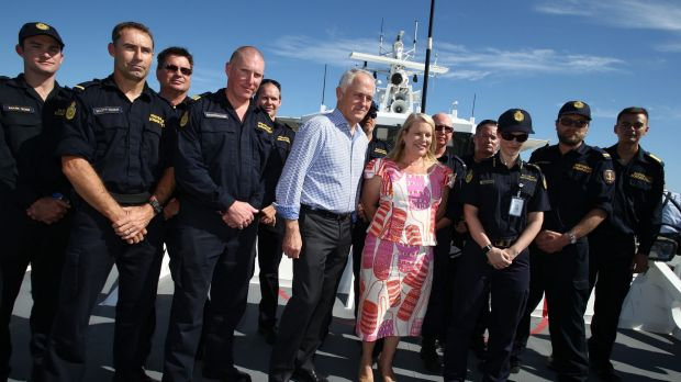 Mr Turnbull with Border Force members and Coalition MP Natasha Griggs.