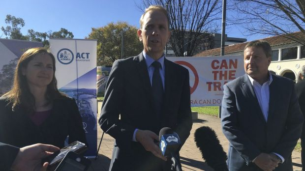 Capital Metro Minister Simon Corbell (centre) announces the signing of contracts, with Canberra Metro consortium chief ...
