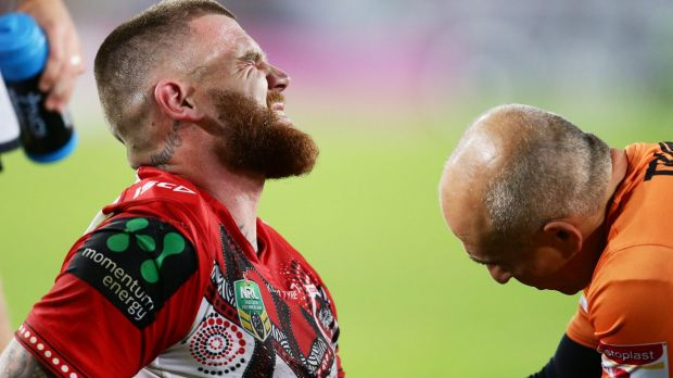 Painful blow: Josh Dugan shows discomfort after suffering an arm injury during the round 11 NRL match between the South ...